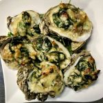 Baked James River Oysters with Spinach, Fennel, Bacon, Parmesan Reggiano, Pernod and Cream.